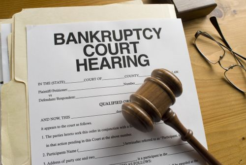 Bankruptcy Court Hearing Document and Judges gavel on a desktop.