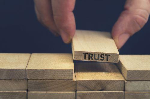 Trust word written on wooden block.